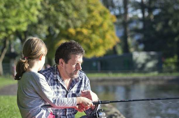 father and daughter fishing at cyfartha park lake